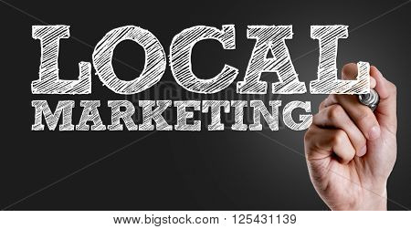 Hand writing the text: Local Marketing