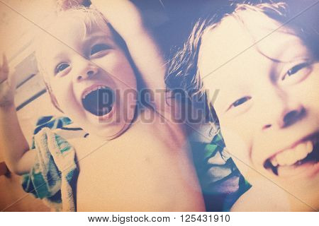 Laughing brothers selfie, filtered, snapshot image, noise added.