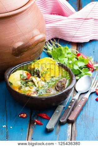 Latinamerican food. Cazuela - traditional chilean latinamerican soup served in clay plate from pomaire