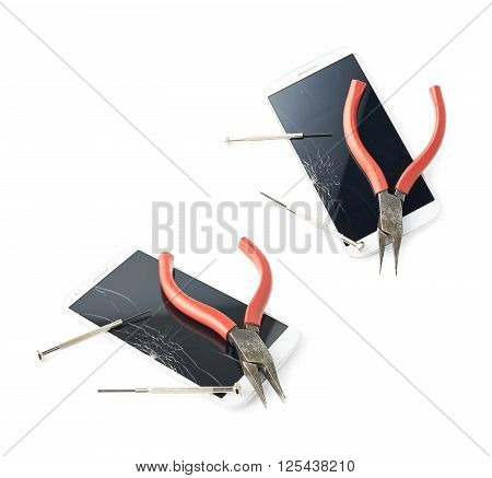 Lineman's pliers and screwdrivers over the crecked broken phone's screen, composition isolated over the white background, set of two foreshortenings