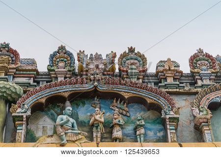 Trichy India - October 15 2013: Closeup of a statue scenery at Ranganathar Temple showing Lord Rama the Lord Vishnu avatar mapping the attack on Sri Lanka to liberate his wife Sita in front of his brother Lakshman with arrows and Hanuman.