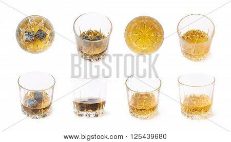 Glass tumbler filled with whiskey bourbon isolated over the white background, set of multiple image versions with and without the cooling granite stones