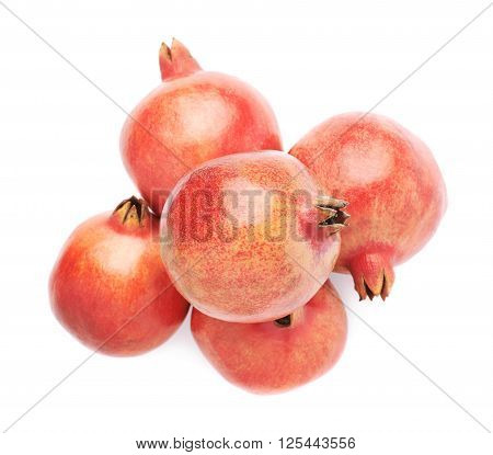 Pile of multiple pomegranate Punica granatum fruits isolated over the white background poster