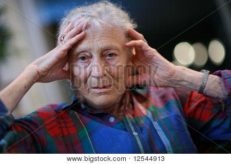 Senior Woman Holding Head
