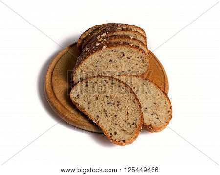 multigrain sliced bread on a wooden round plank on white background