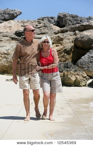 Portrait of a senior couple walking on the beach
