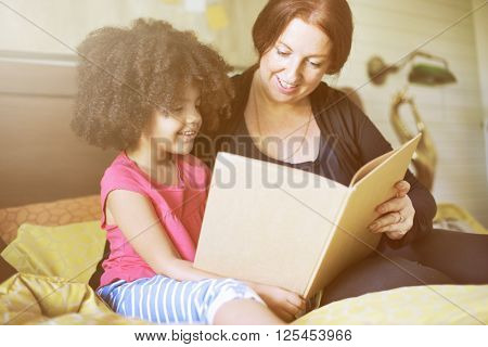 Parenting Mother Child Love Reading Concept