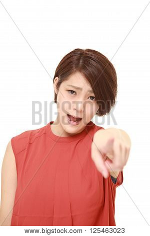 studio shot of young Japanese woman shocked