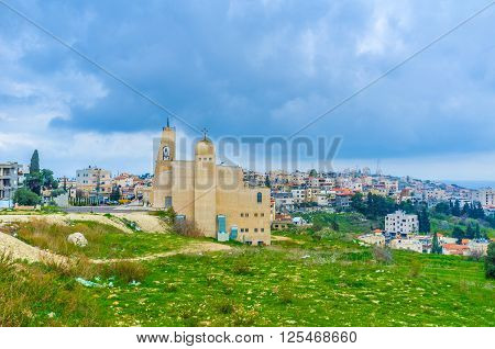The view on the residential neighborhood with modern church Alzainit on the foreground Nazareth Israel.