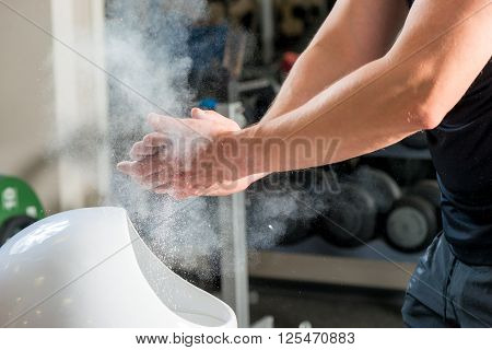 Male Weightlifter Processes Hands Talcum Powder Against Sliding