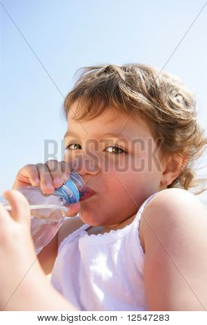 Portrait of a little girl with a bottle of water