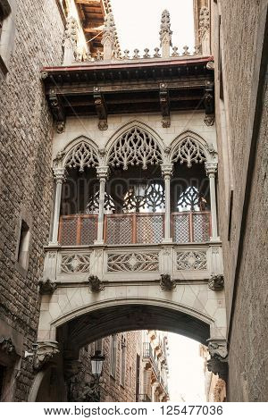 Ancient Arch And Balcony Over Carrer Del Bisbe