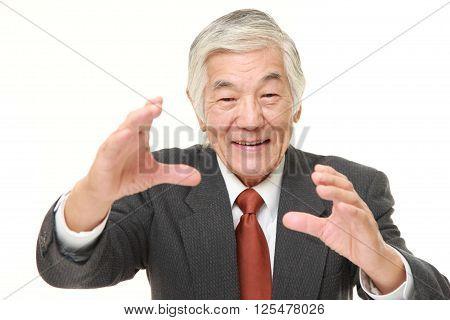 studio shot of senior Japanese businessman with supernatural power