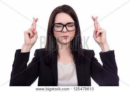 Hopeful Business Woman Holding Fingers Crossed Isolated On White