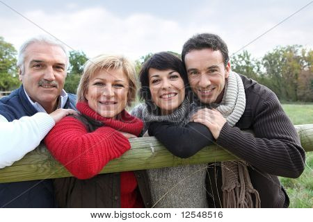 Portrait of men and women smiling in the countryside