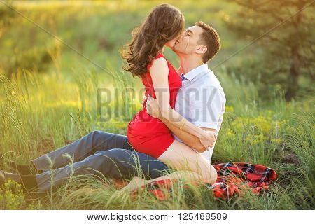 Beautiful Young Couple Have Romantic Dating in Park. Happy Man and Woman Kissing and Fall in Love Outdoor. Relationships