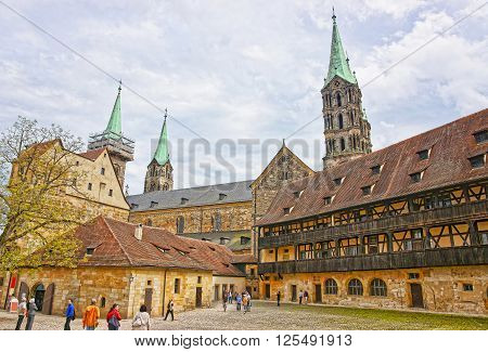 BAMBERG GERMANY - MAY 9 2013: Old palace and Bamberg Cathedral in the city center of Bamberg in Germany. The Cathedral is also called Bamberger Dom St Peter und St Georg.