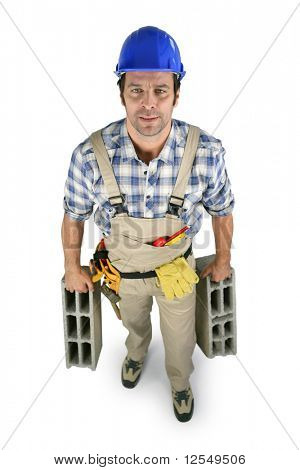 Workman carrying cinderblocks on white background