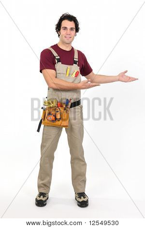 Workman in overalls on white background