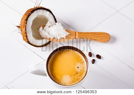 Bulletproof coffee it's a coffee blended with butter or coconut oil. Wiev from above on coffee and coconut. Part of ketogenic diet better choice before trainning. poster