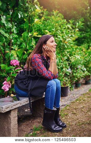 Pretty Young Nursery Worker Sitting Daydreaming