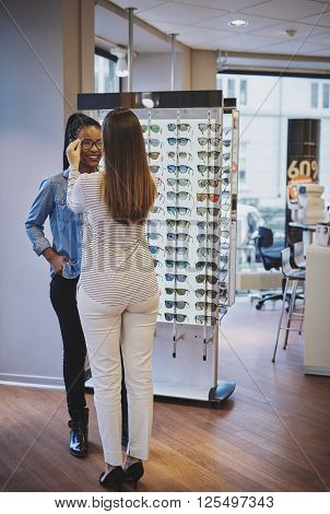 Optometrist Fitting Glasses For A Customer