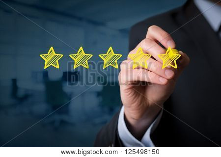 Review increase rating performance and classification concept. Businessman draw five yellow stars to increase rating of his company office in background.