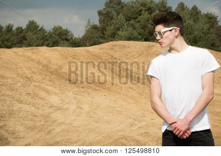 Portait of a teenage boy in a park