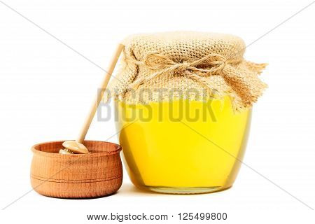 May honey in jar on white background