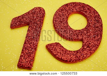 Number nineteen red color over a yellow background. Anniversary. Horizontal