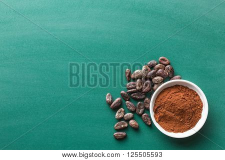 cocoa powder and cocoa beans on chalkboard