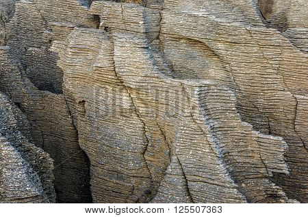 Pancake Rocks in Paparoa National Park New Zealand. Close up of layered rock formation. Punakaki rocks texture details. Pancake rocks are famous tourist destination for South Island New Zealand