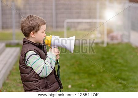 Little Boy Screaming Through A Megaphone