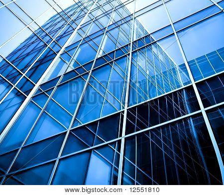 modern glass apartment blocks of skyscrapers at night