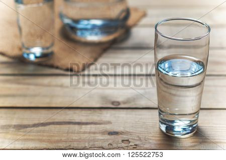 Glasses Of Water On Wooden Table. Selective Focus.