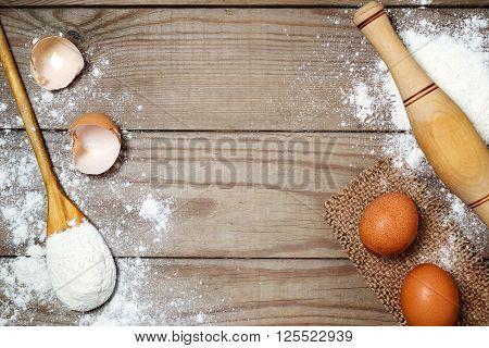 Eggs, Flour On The Wooden Table.