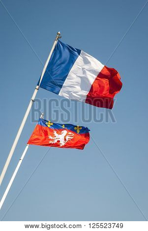 Waving Flags Of France And Lyon City