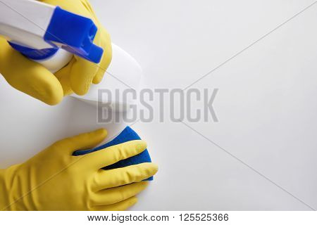 Hands Of Cleaning Staff With Cleaning Tools On Table Top