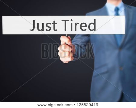 Just Tired - Businessman Hand Holding Sign