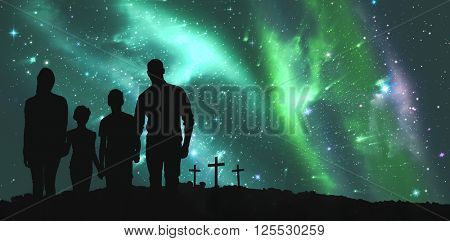 Portrait of happy family walking over white background against cross religion symbol shape over sky with aurora borealis