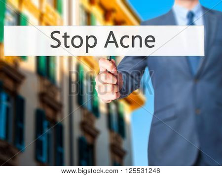 Stop Acne - Businessman Hand Holding Sign