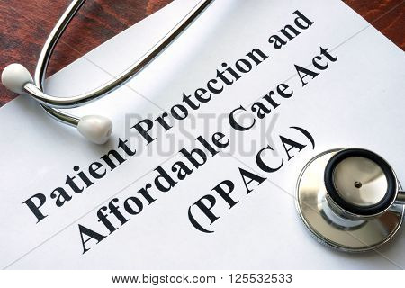 Words Patient Protection and Affordable Care Act PPACA written on a paper and stethoscope.