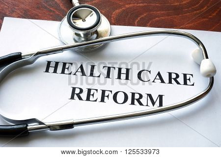 Words health care reform written on a paper.