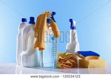 Cleaning Products And Equipment On White Table Overview