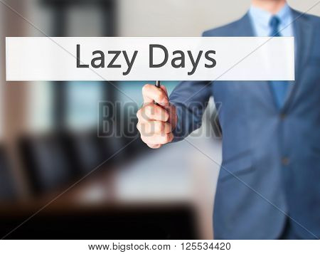 Lazy Days - Businessman Hand Holding Sign