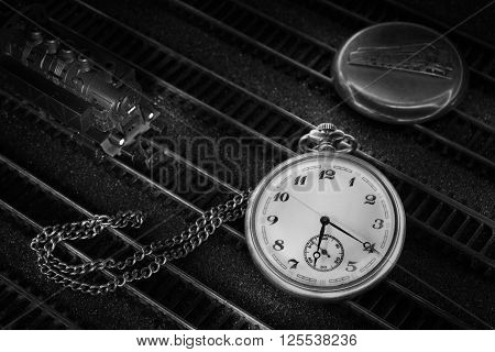 Pocket watch with train locomotive cover and chain on rails