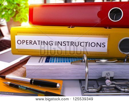 Yellow Ring Binder with Inscription Operating Instructions on Background of Working Table with Office Supplies and Laptop. Operating Instructions Business Concept on Blurred Background. 3D Render.