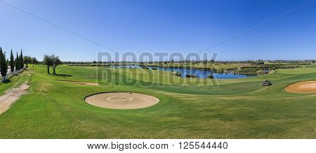 Panorama of a golf course and sand traps.