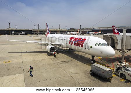 Brasilia Brazil - December 2 2015: TAM Airlines Airbus 320 parked at Brasilia International Airport Brazil. TAM is the Brazilian brand of Latam Airlines and the largest Brazilian airline.