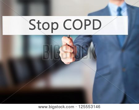 Stop Copd - Businessman Hand Holding Sign